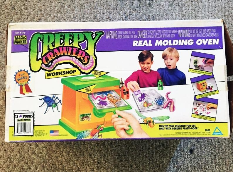 A early '90s box for Creepy Crawlers workshop featuring two kids making bugs.