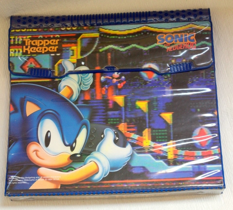 A Trapper Keeper featuring Sonic the Hedgehog playing a Sonic game.