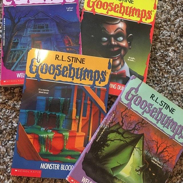 """Four """"Goosebumps"""" books scattered."""