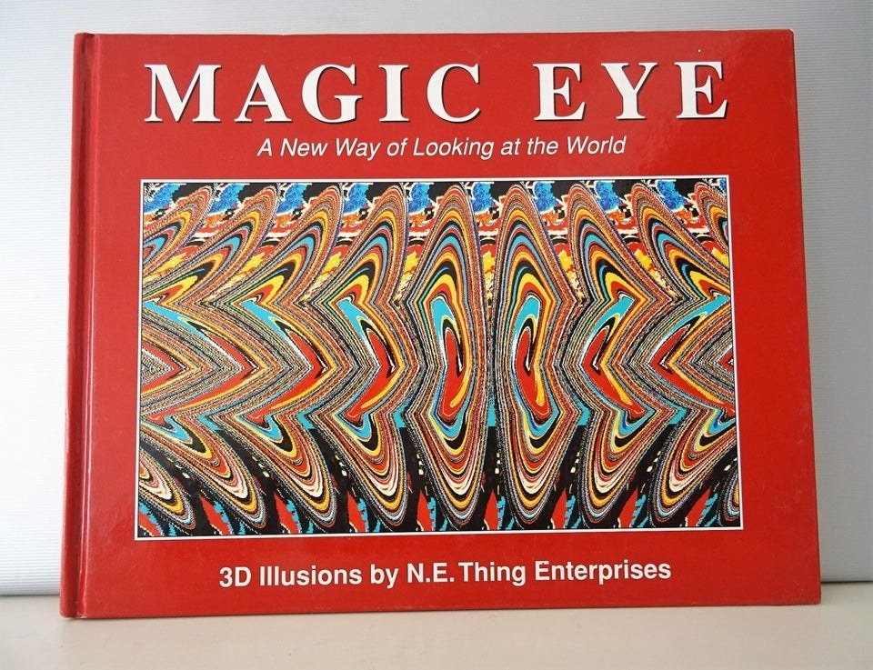 "A close-up of the cover of a red ""Magic Eye"" book."