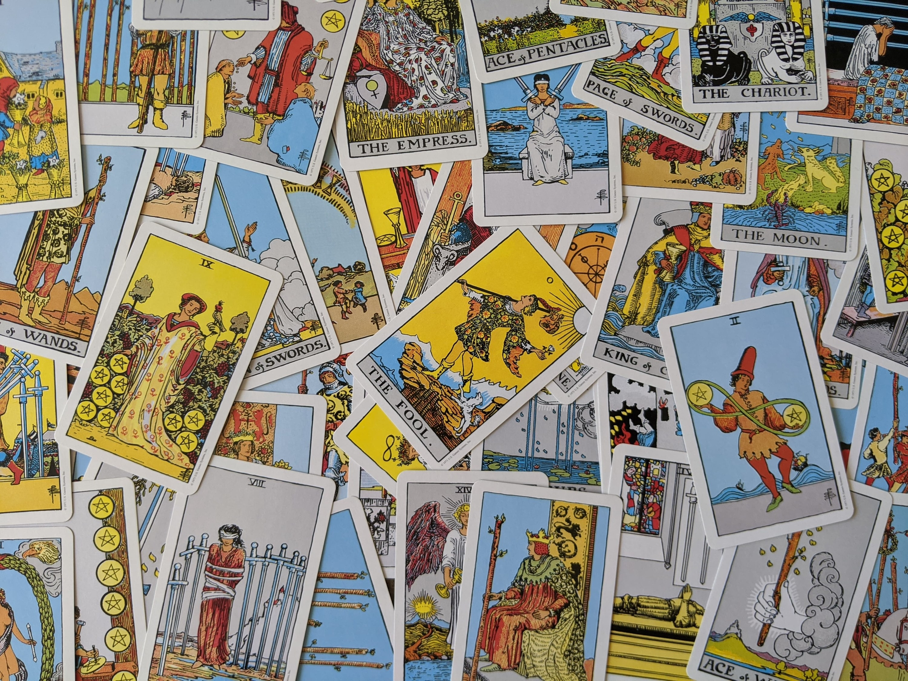 The cards of the Rider-Waite tarot deck are spread out, face up