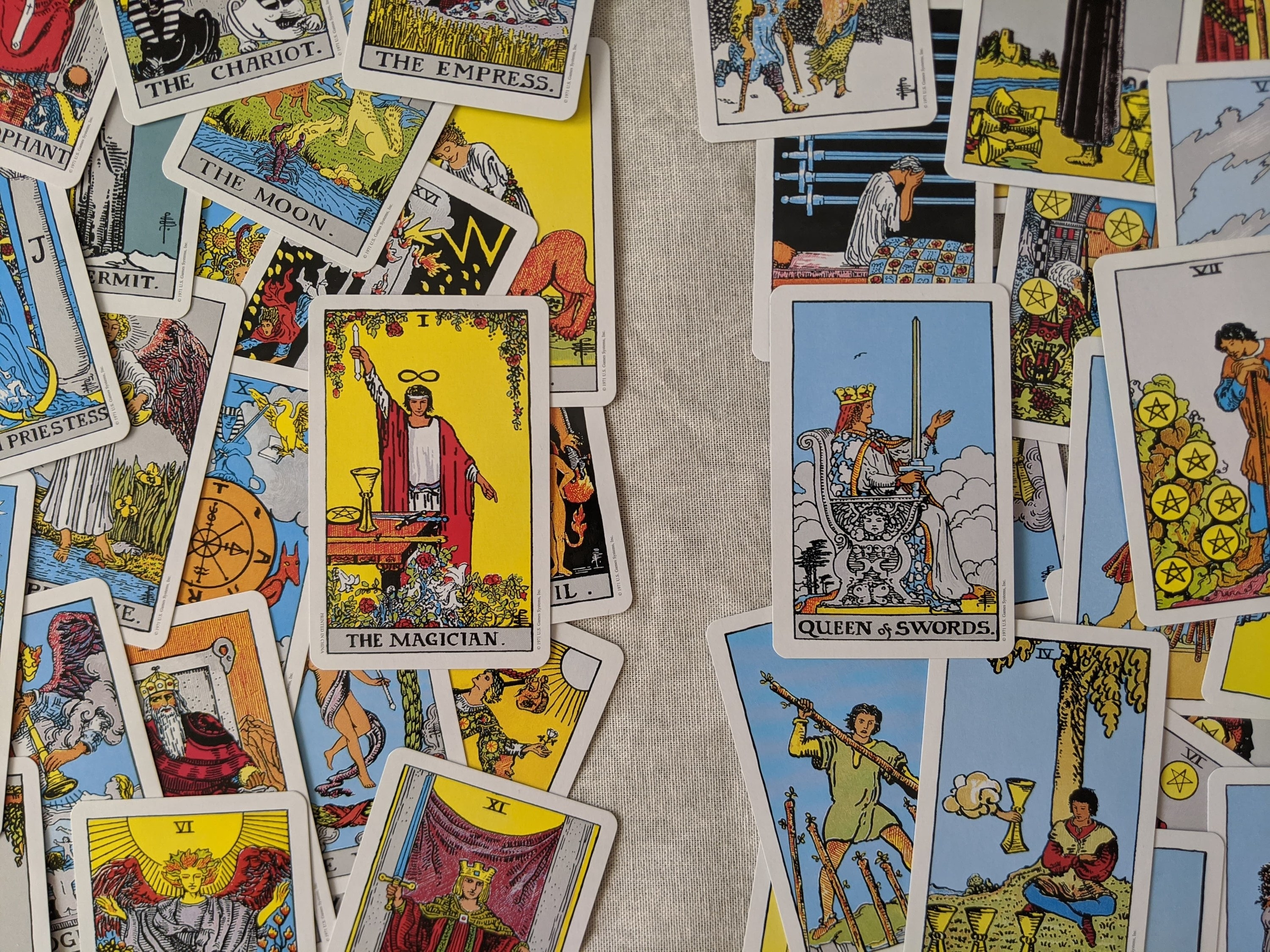 The cards of the Rider-Waite deck lay face up, divided with the Major Arcana cards on the left and Minor Arcana cards on the right