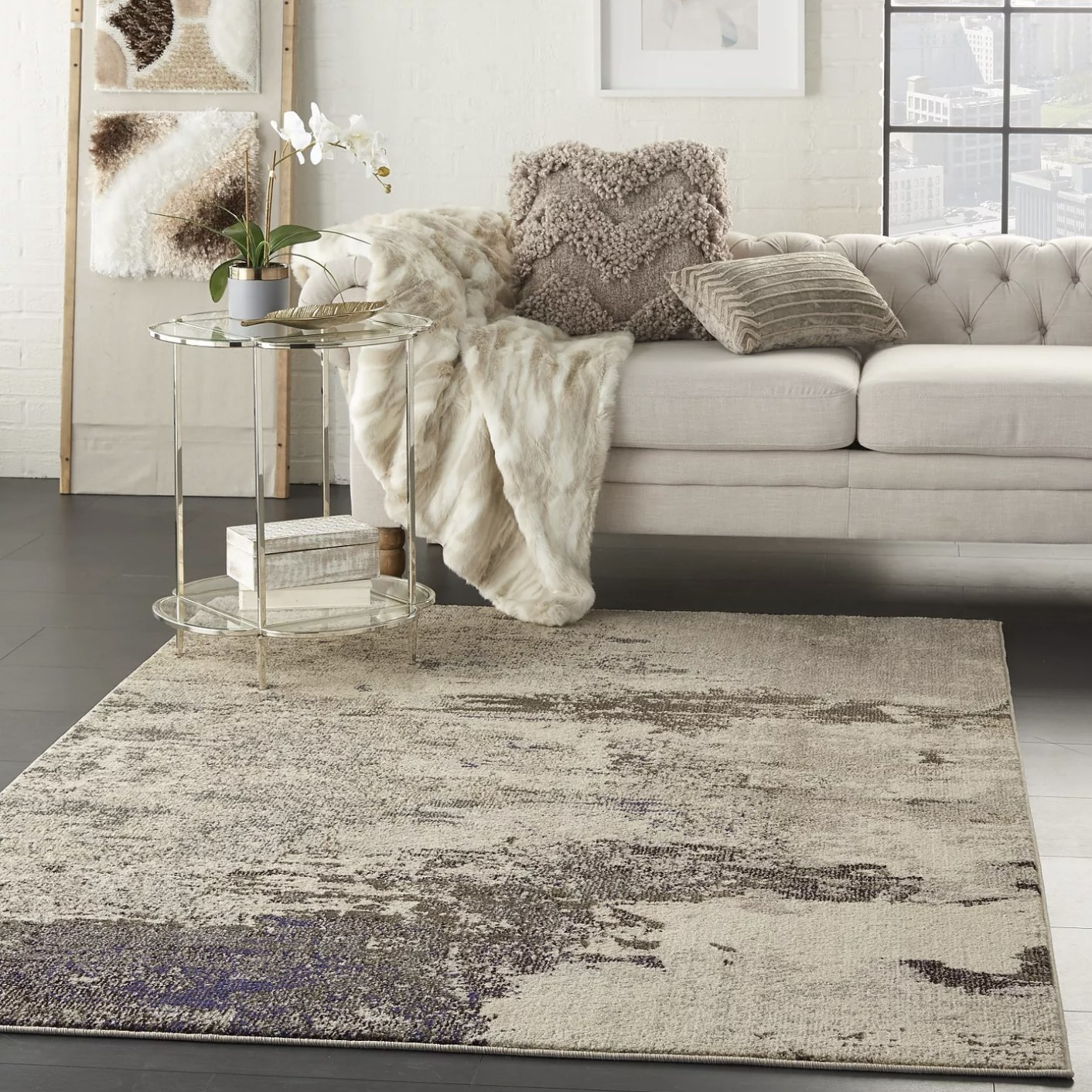 a tan slightly patterned area rug