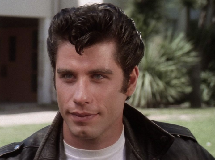 John Travolta smiling in Grease