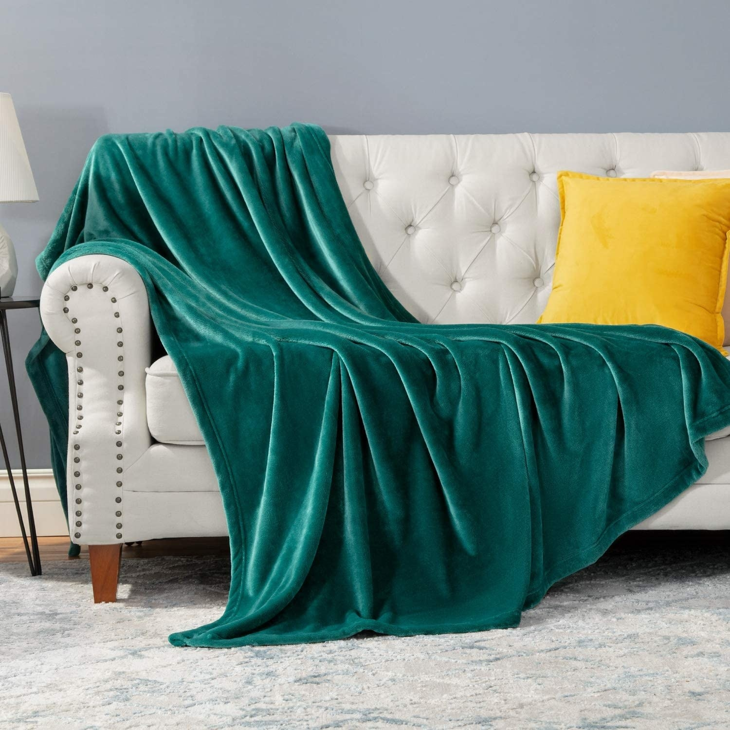 A throw blanket draped over a couch