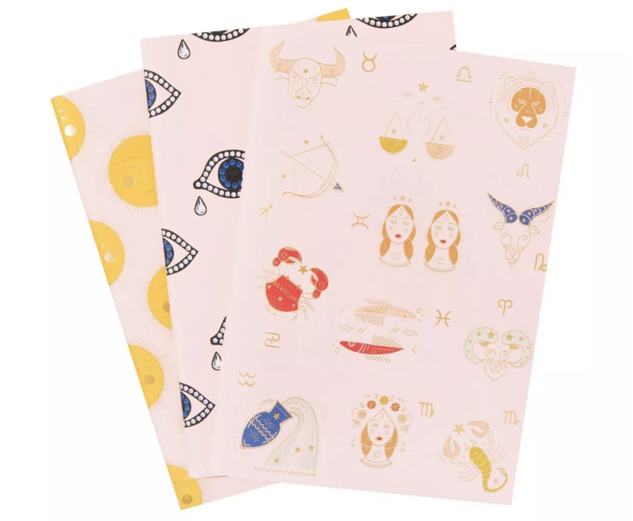 Pale pink notebooks with cartoon designs on them