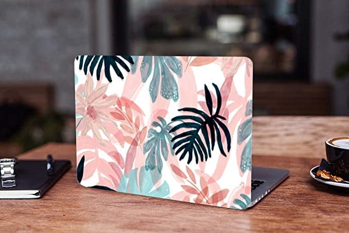 Laptop skin with a colourful floral leafy print.