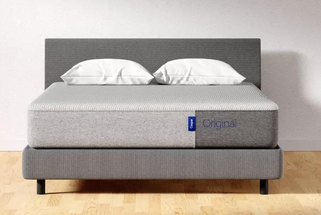A gray Casper mattress on a bed