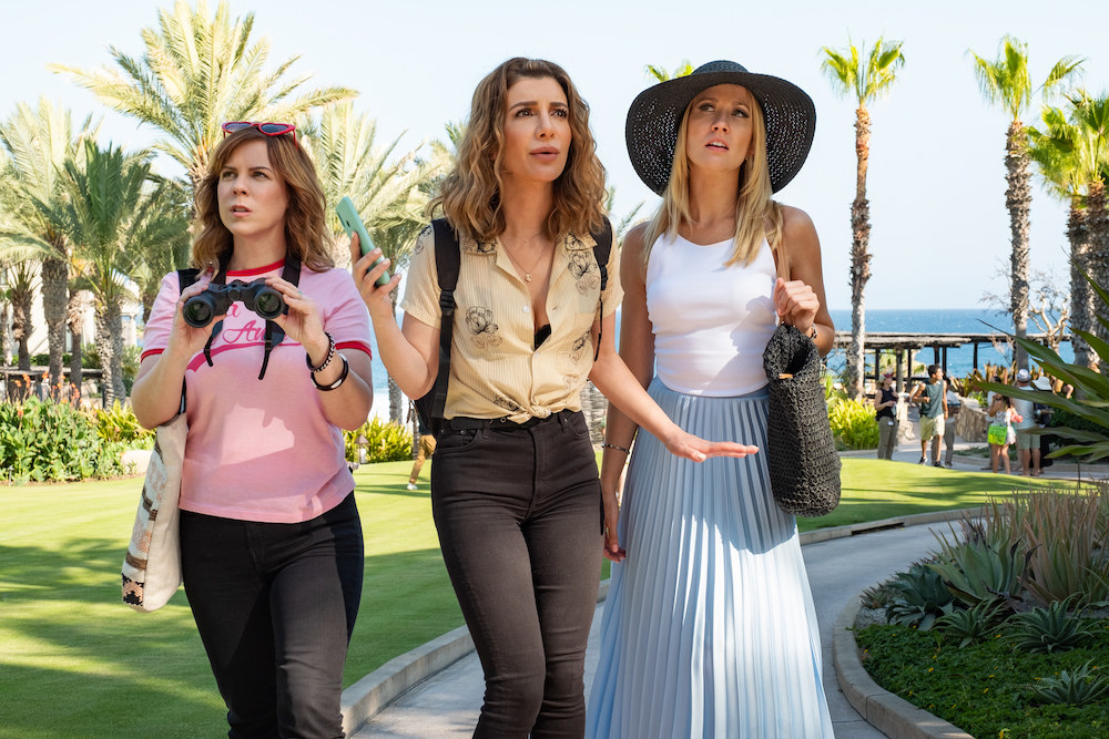 The lead actresses of the Desperados movie on Netflix stand looking bewildered at a resort in Mexico.
