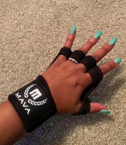 Reviewer wears a black ventilated glove around their hands and wrist