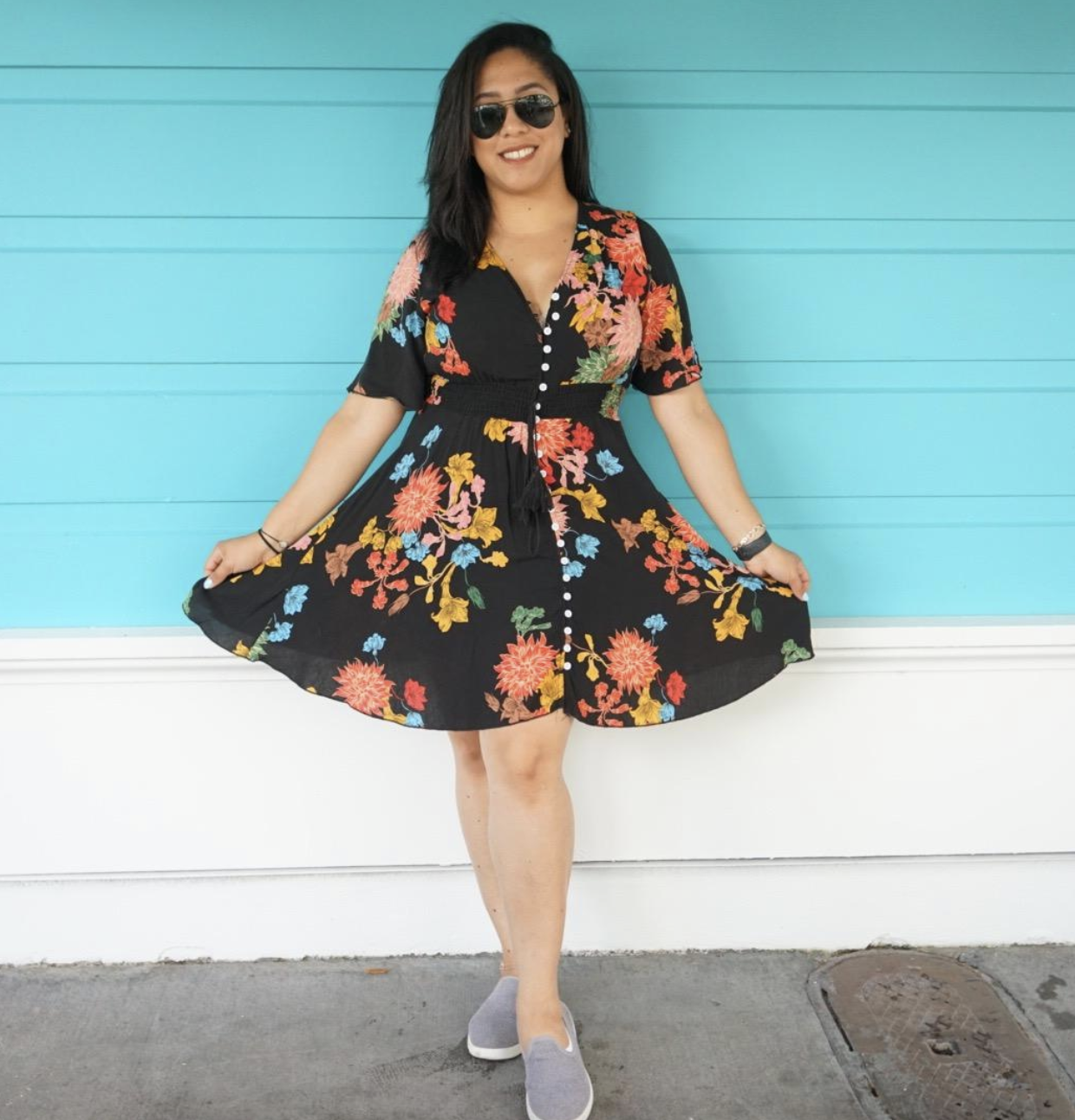 reviewer wearing black and floral V-neck mini dress