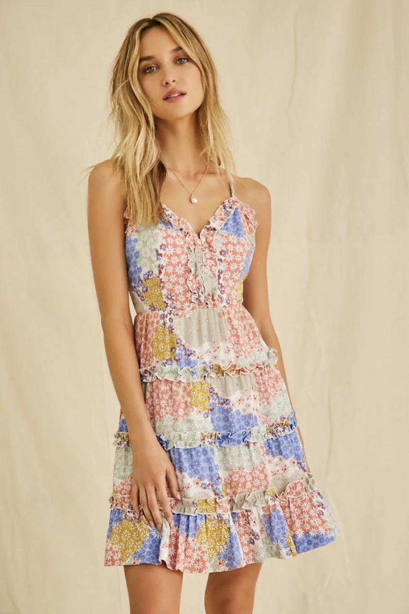 A model in the sleeveless tiered dress, which falls just above the knee