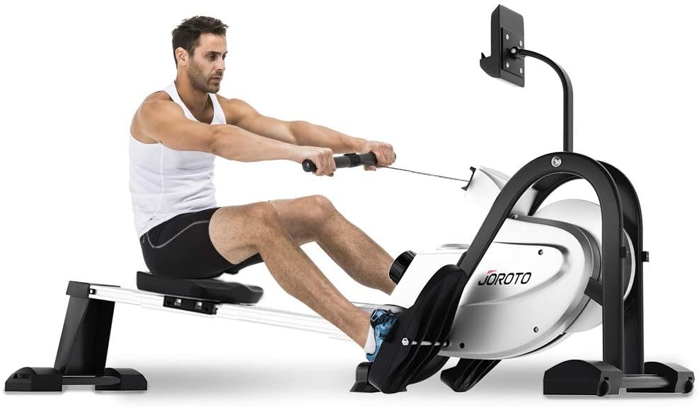 A person sitting on the rowing machine with their feet on the footrests and their arms outstretched, pulling the weighted cord
