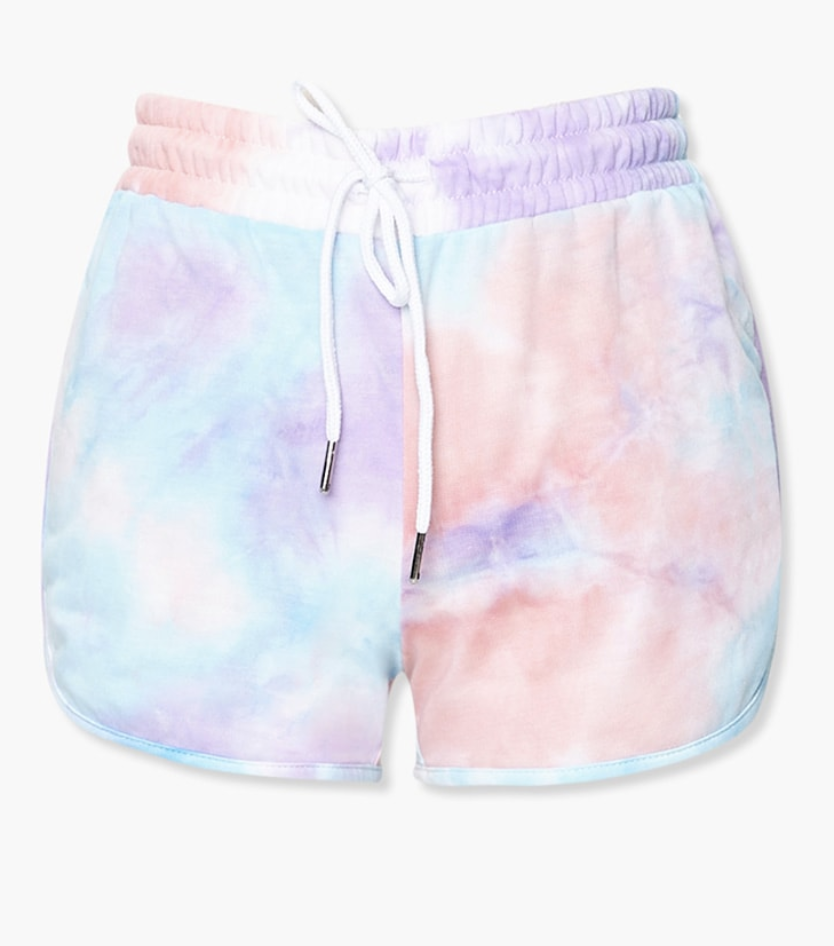 cotton shorts in a light pink light blue and light purple tie dye and a white drawstring around the waist