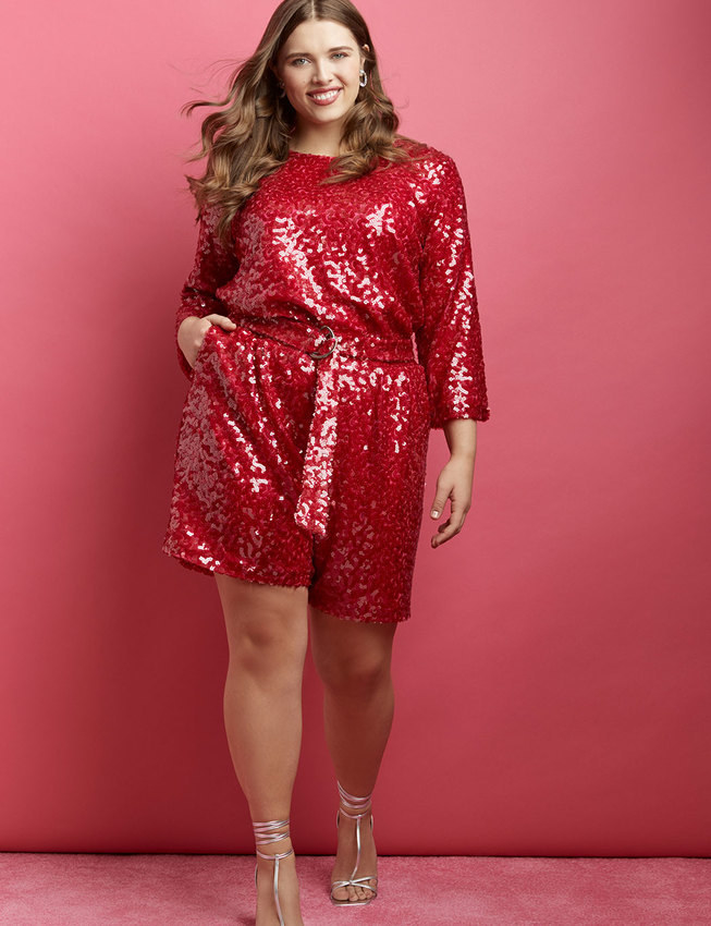 a model in the red high waisted sequin shorts