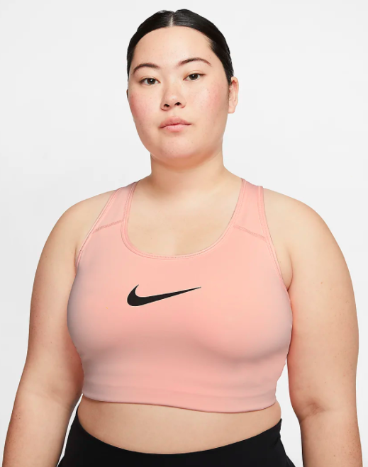 Model wears pink Nike Swoosh Women's Medium Support Sports Bra