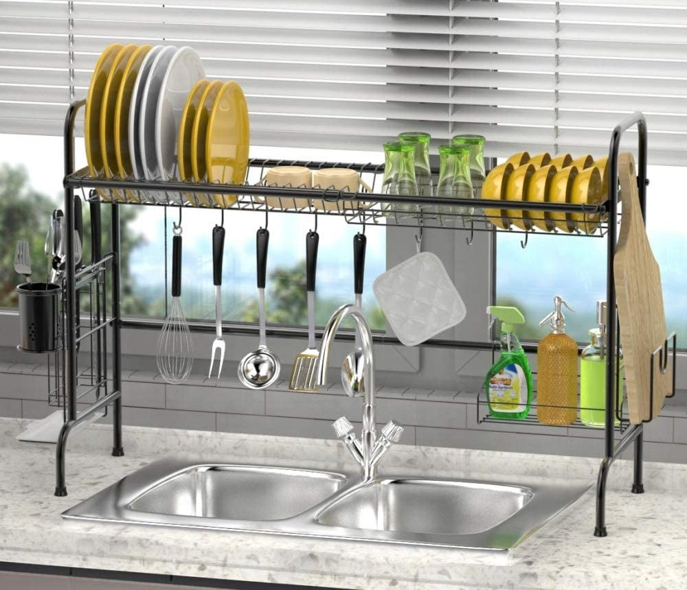 An over-the-sink organizer and dish rack with many items on it