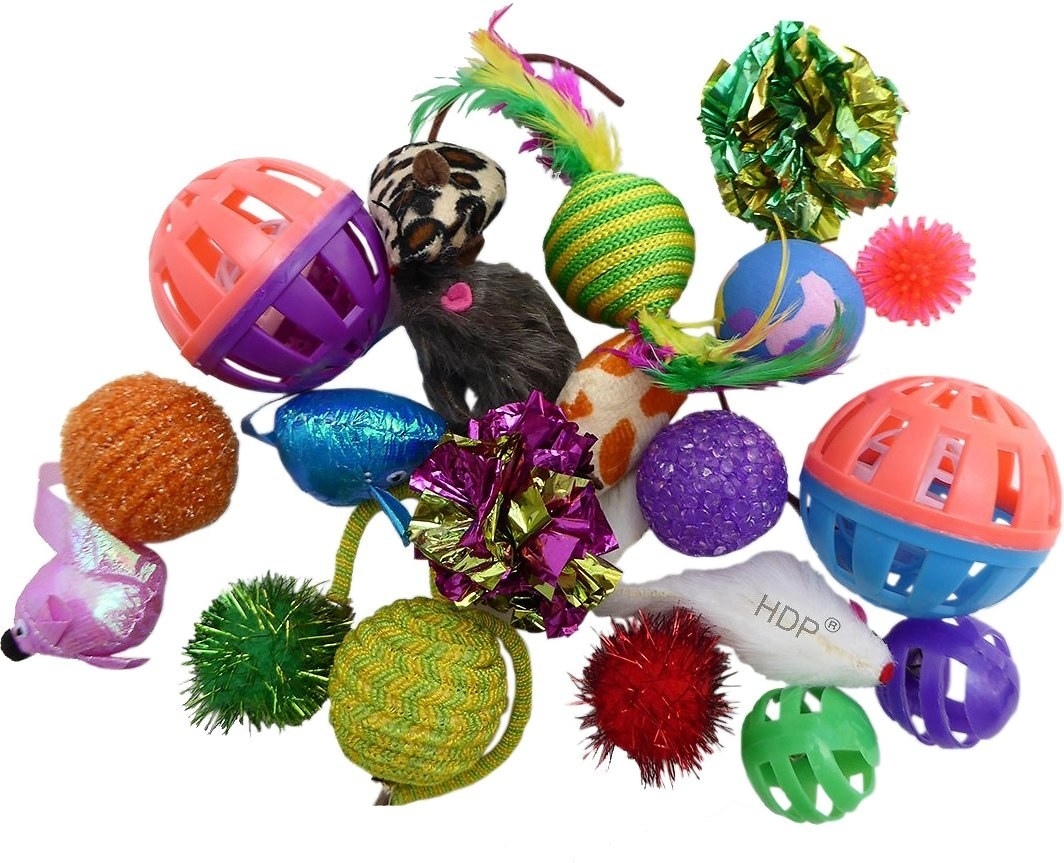 Close-up of assorted mice, balls, and other cat toys