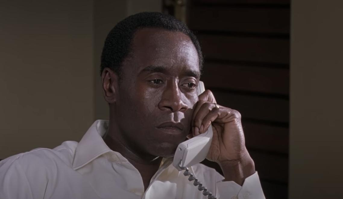 Don Cheadle on the phone in Hotel Rwanda