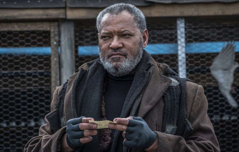 Laurence Fishburne holding a letter