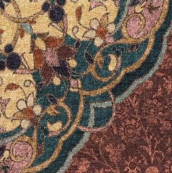 a close up on the intricate rug showcasing the small hidden mickeys