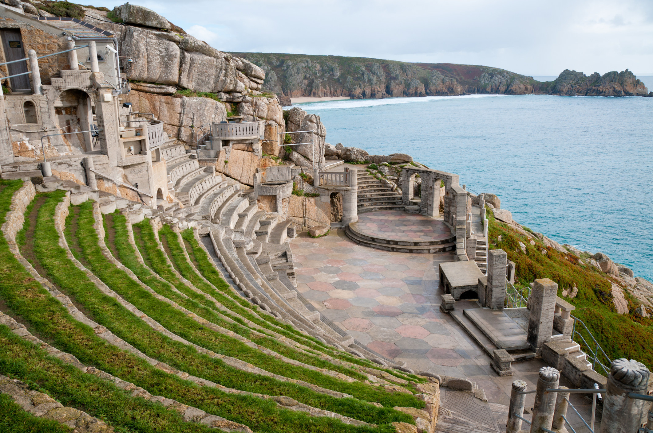 The outside theatre made from stone is perched on a cliff – you can see the cliffs of Cornwall in the background with the sea below