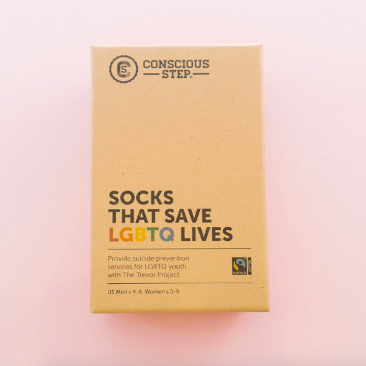 "A box that says ""Socks That Save LGBTQ Lives"""