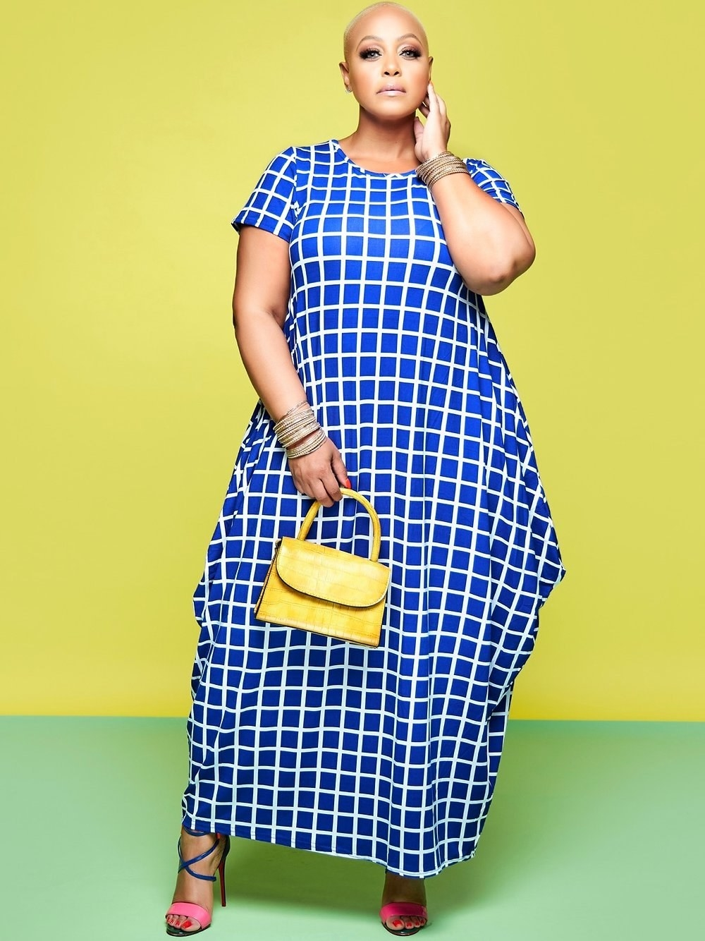 Model wearing the t-shirt maxi dress that goes down to the ankle in blue with a white checkered print