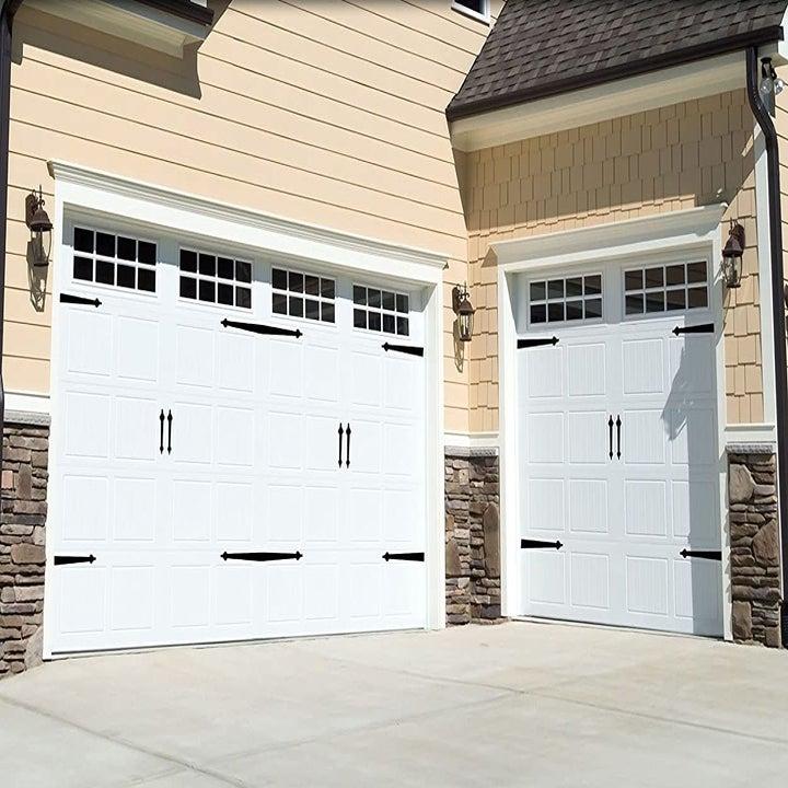 The black magnets on white garage doors