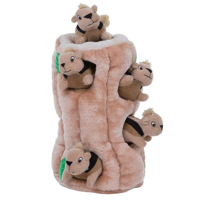 A plush toy shaped like a tree with toy squirrels hidden inside
