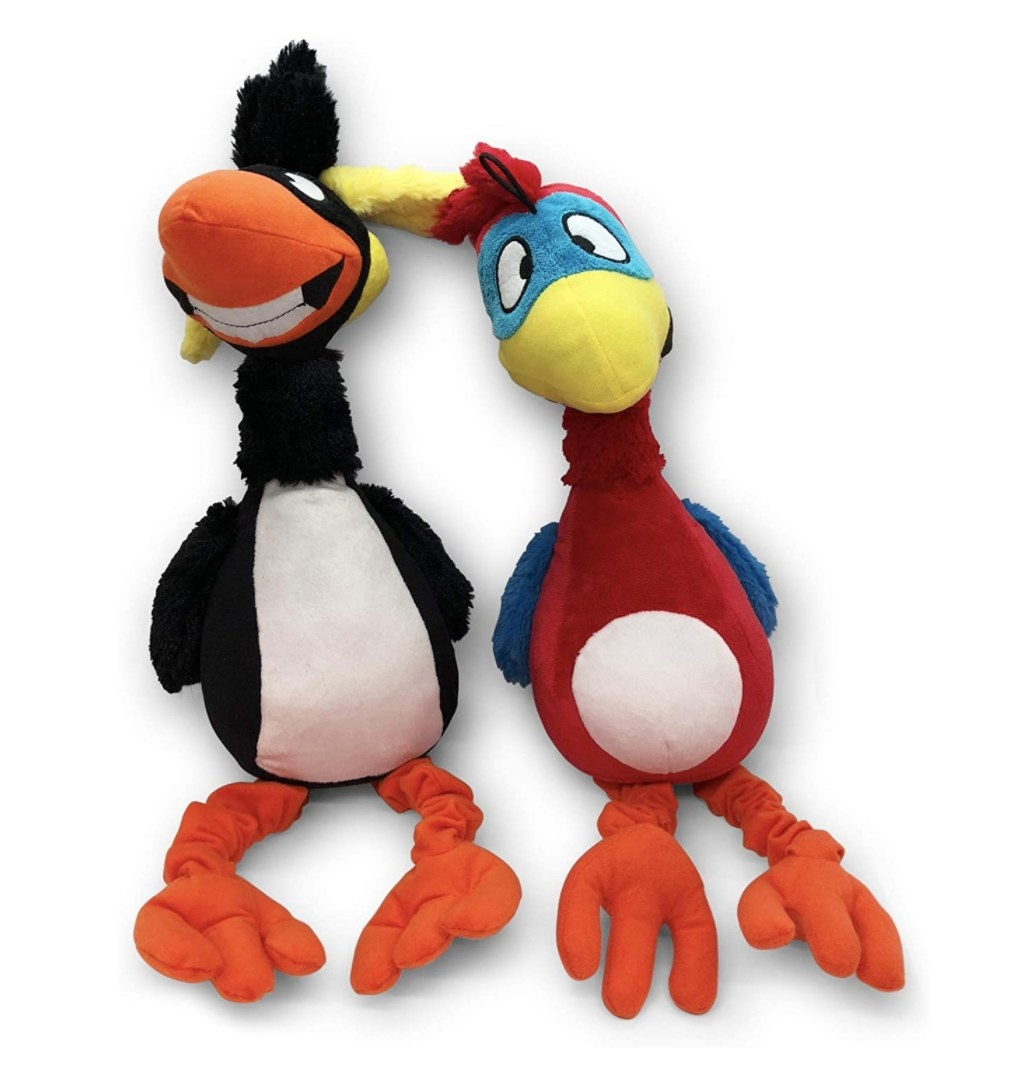 A black and orange puffin and red and blue parrot plush chew toys