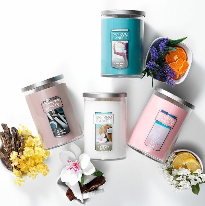 Four Yankee Candles in its tumbler style and in four different scents