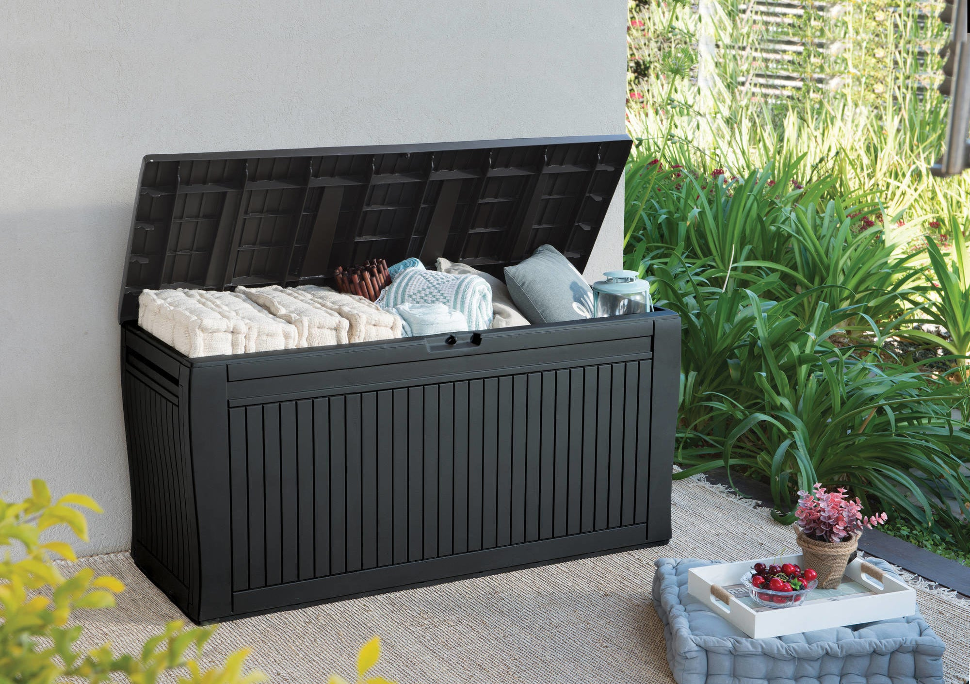 An espresso brown outdoor storage box with the lid open