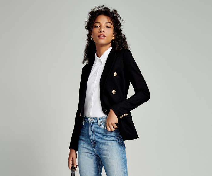 Model wearing the white collar shirt