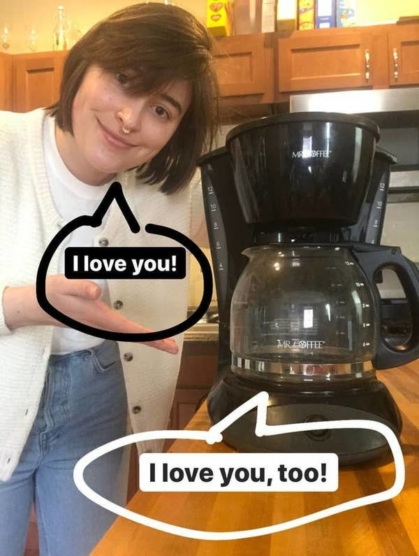 """BuzzFeed shopping writer standing next to the coffee machine with the words """"I love you!"""" and """"I love you, too!"""" in bubbles around both of them"""