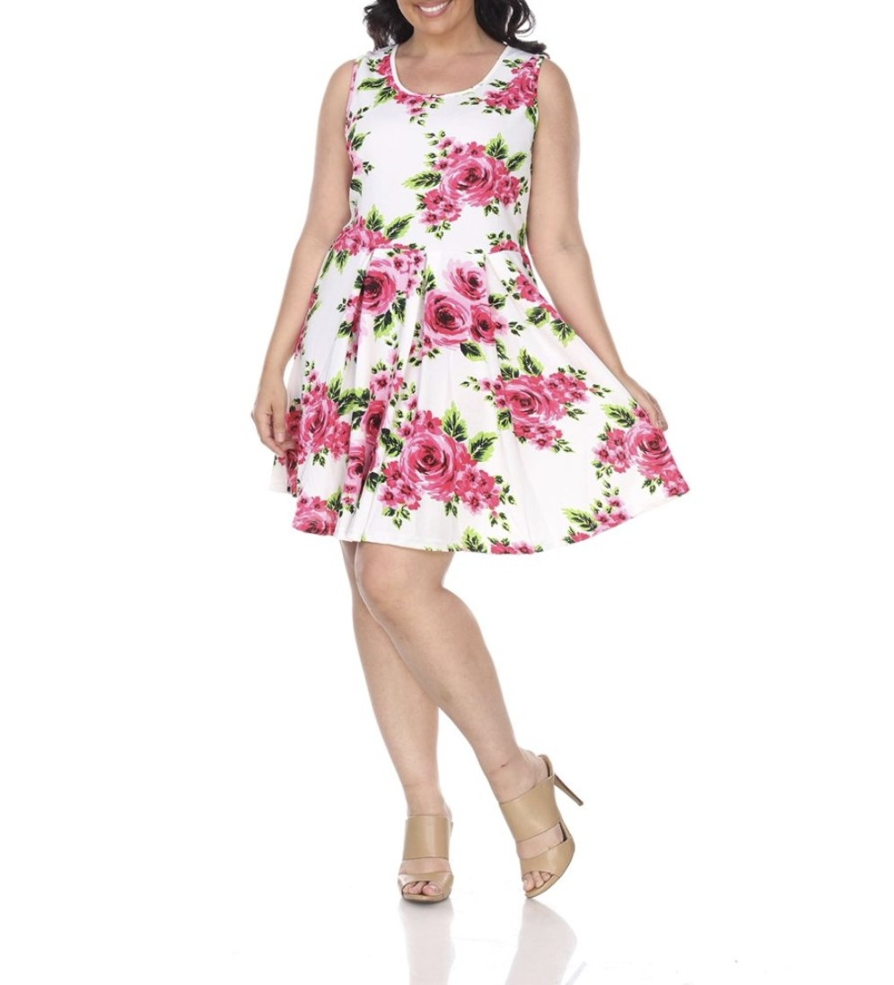 A model in a white dress with pink florals