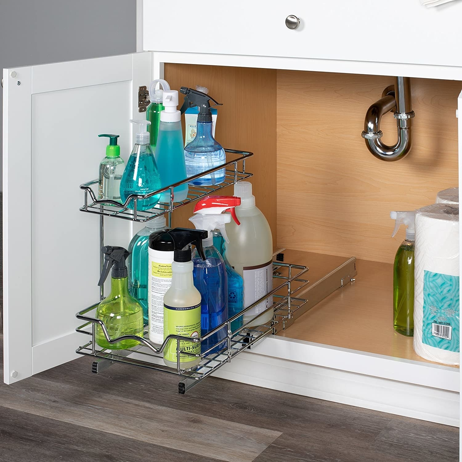 The cabinet organizer filled with cleaning supplies, pulled out from its stand