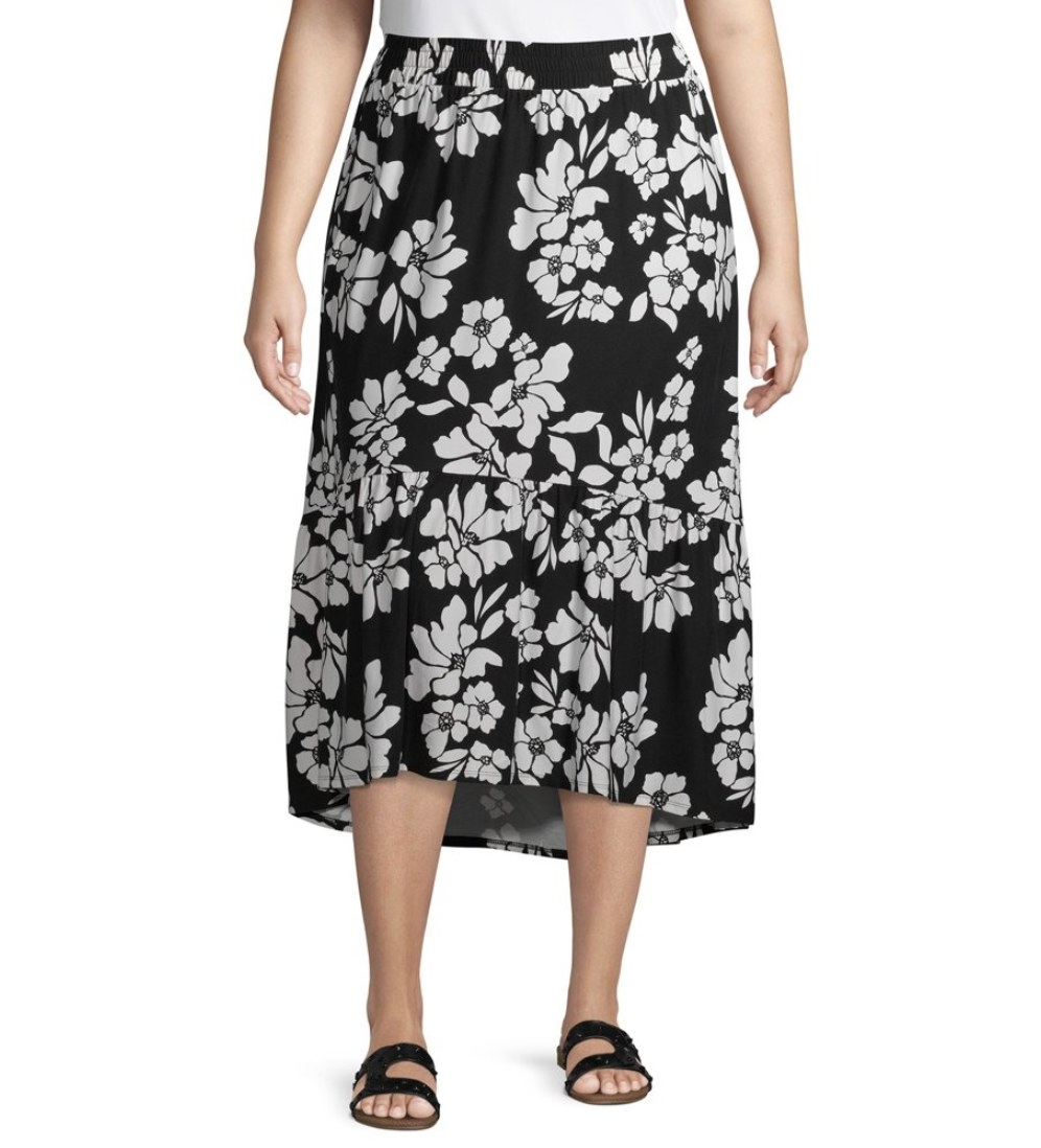 A model in a black mid-length skirt with white florals