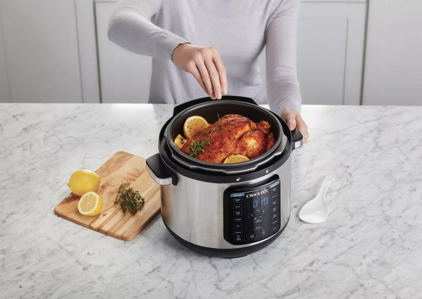 a model cooking a chicken in the crockpot