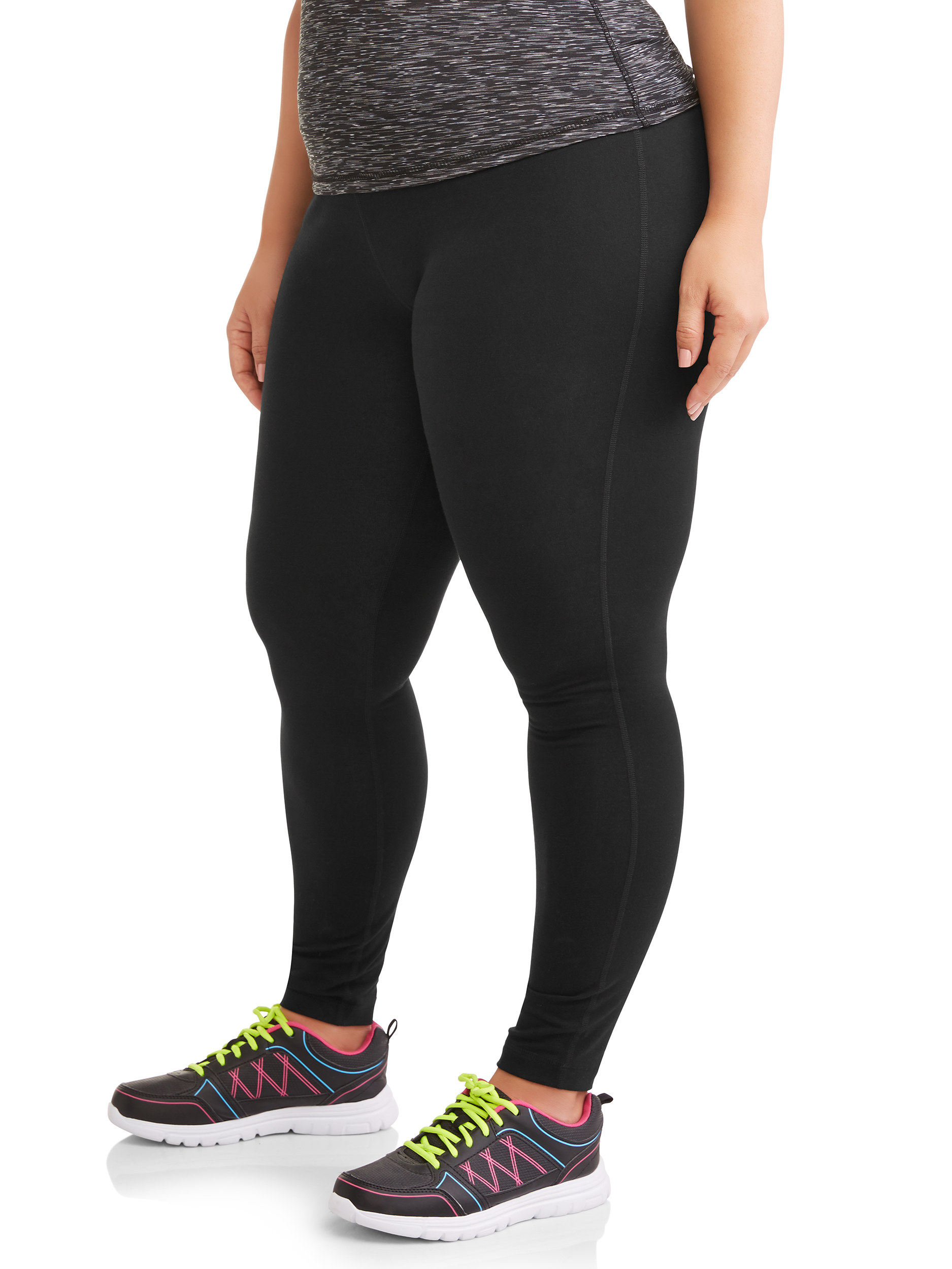 Model wearing the leggings in black with a gray waist band