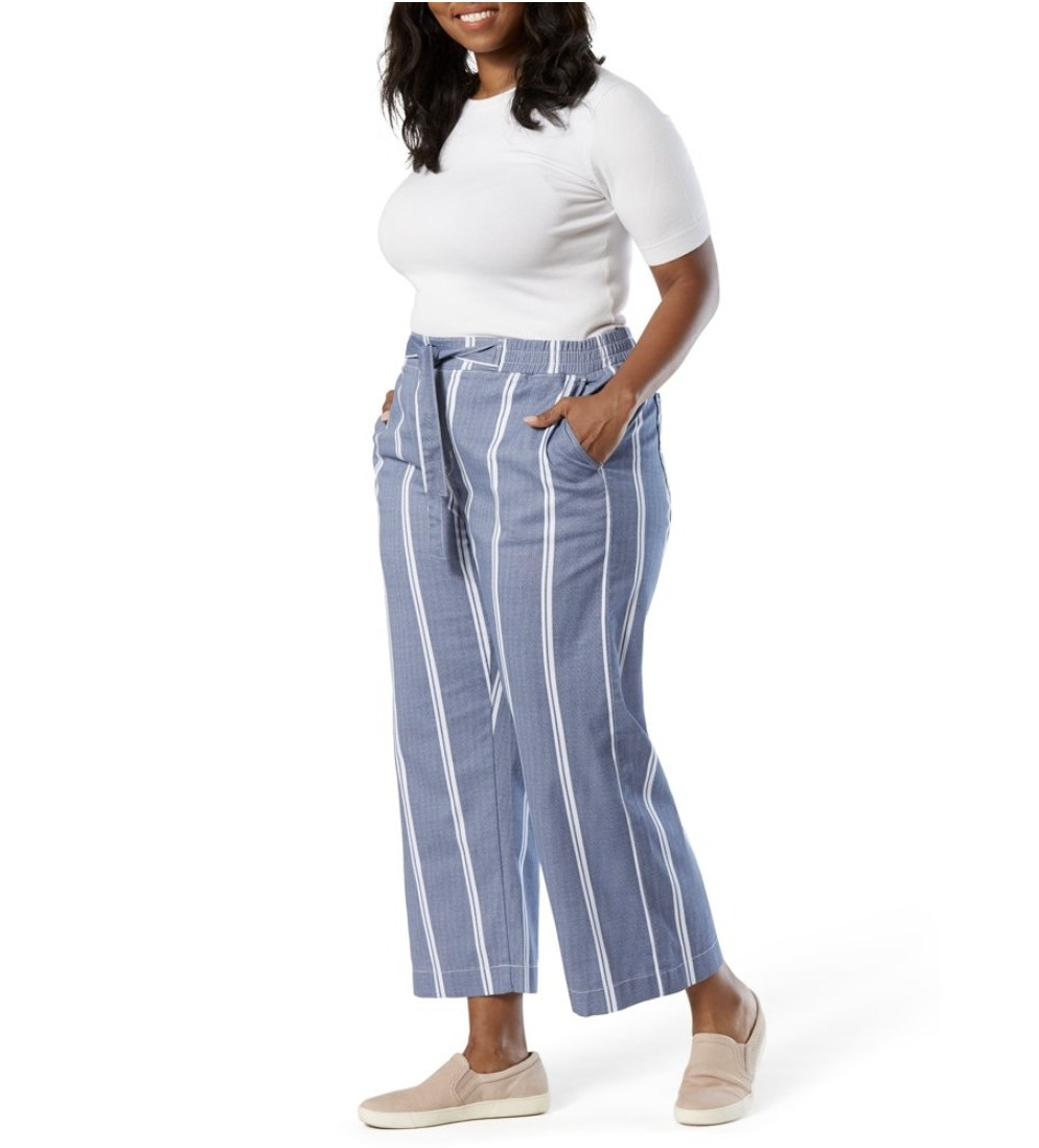 A model in blue and white striped wide-leg pants