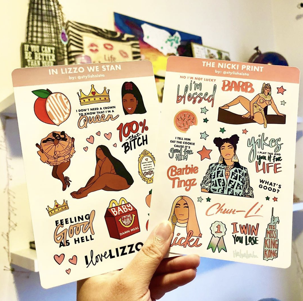 Hand holding the sticker sheets