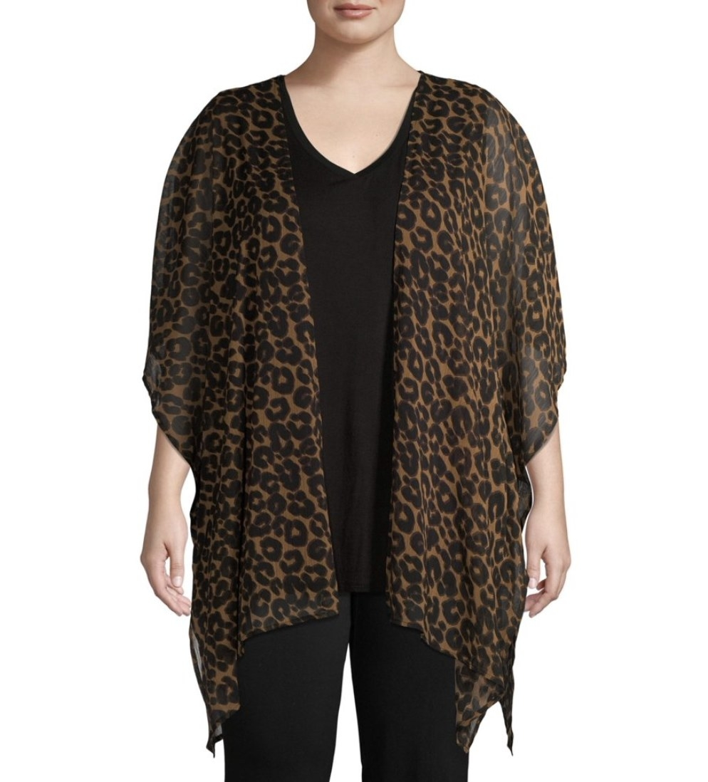 A model in an open draped cheetah print cardigan