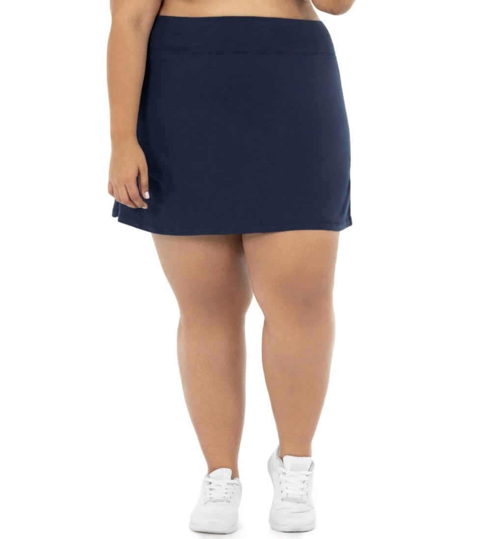 A model in a navy blue skort