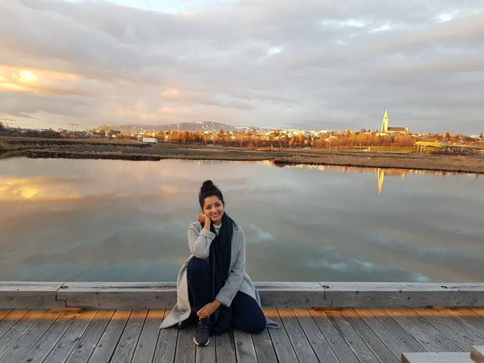 A woman sitting on a boardwalk