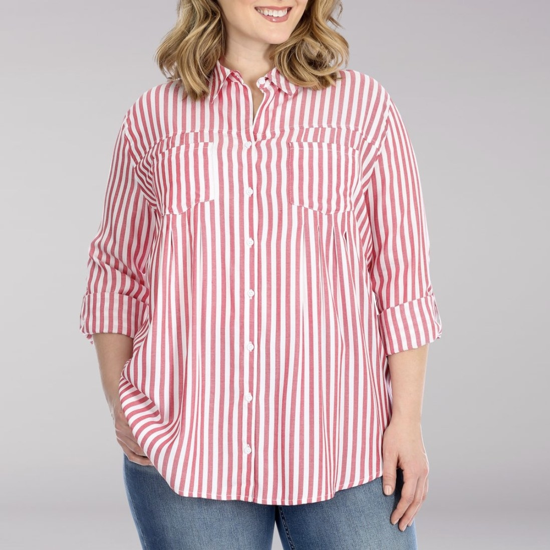 A model in red and white striped button down long-sleeved top