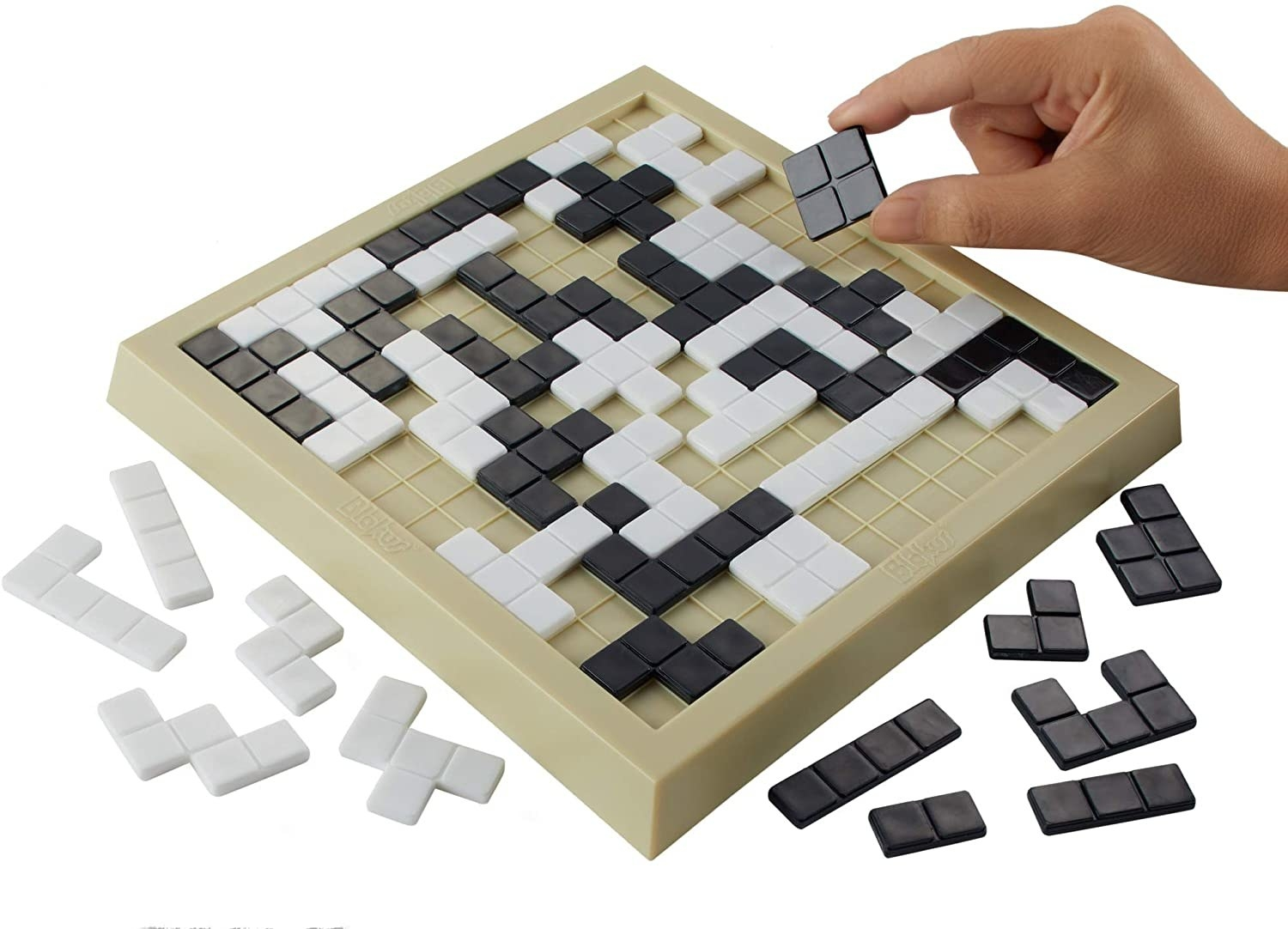 The Blokus board with white and black geometric tiles on it