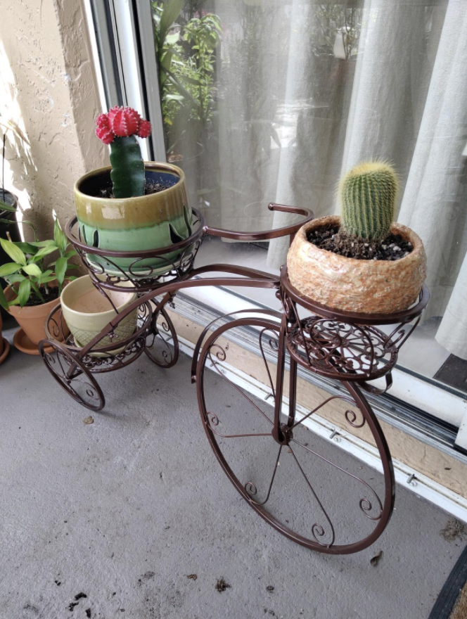 a bronze planter shaped like a bicycle
