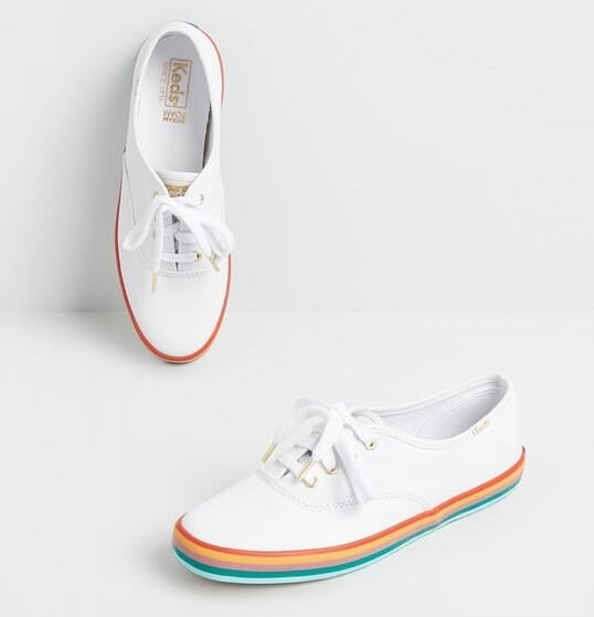 The with lace-up sneakers with red, yellow, pink, teal, and light blue striped bottoms