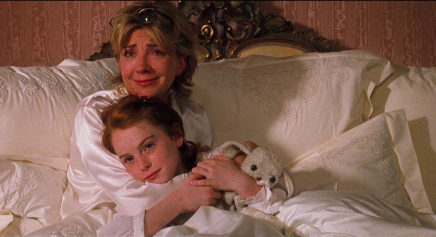 Natasha Richardson and Lindsay Lohan hugging in movie